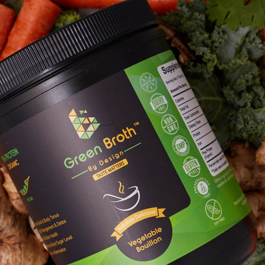 Green broth By Design Jar over ginger, carrots and kale