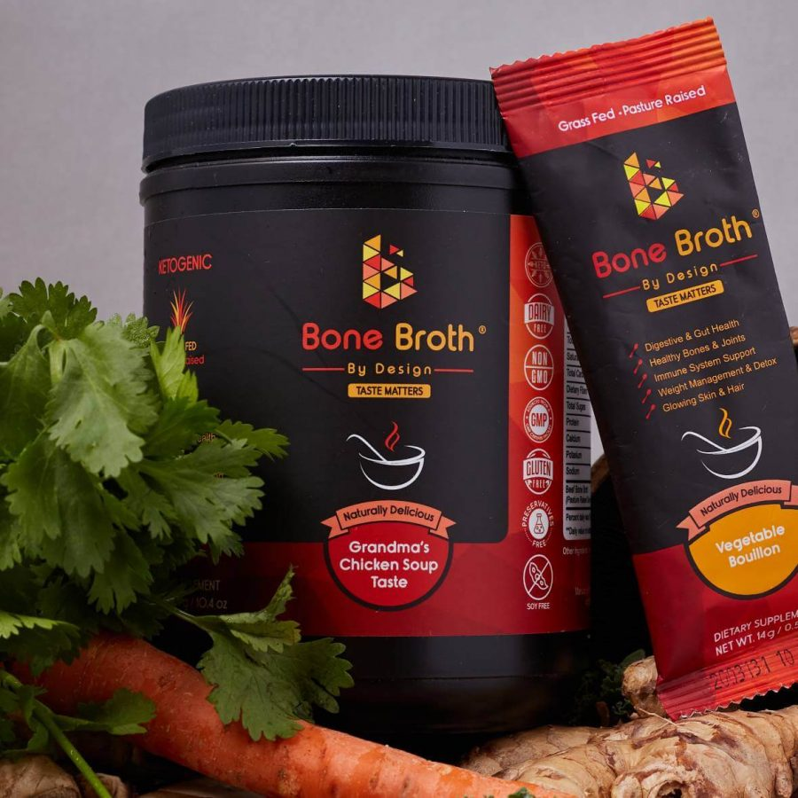 Bone Broth By Design Jar and Sachet next to carrot and parsley