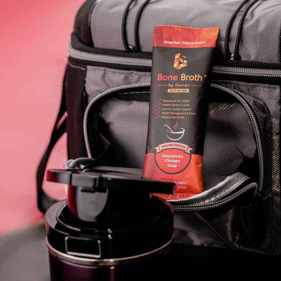 Bone Broth By Design Sachet and a thermos next to a duffle bag