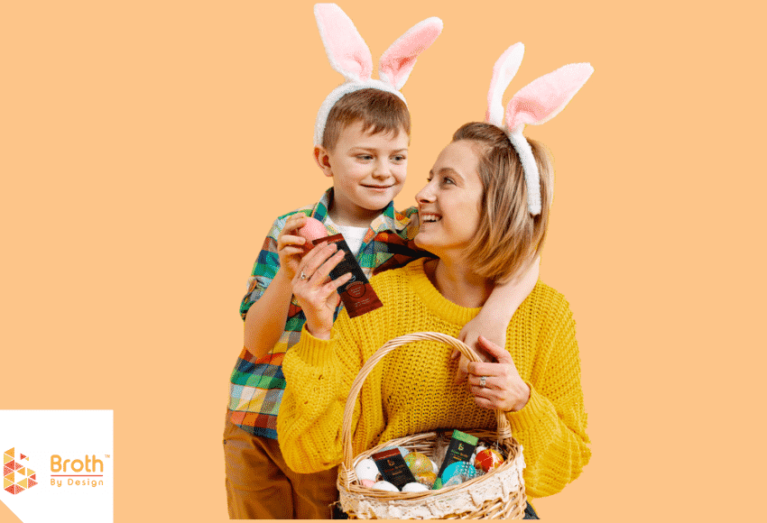 Mother and son ready for Easter. The mother is holding a basket full of easter eggs and Broth By Design's Sachets