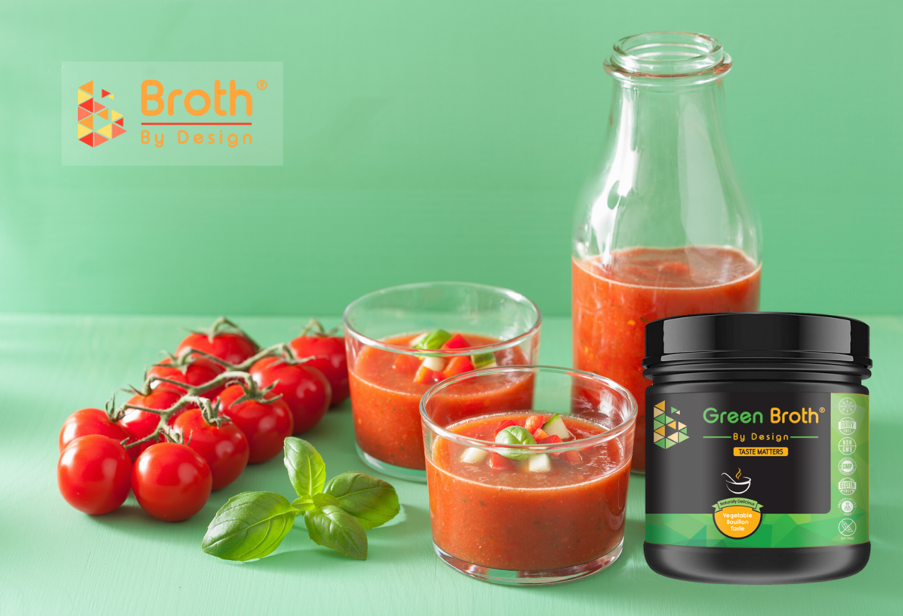 GAZPACHO in glass cups, glass bottle with cherry tomatoes and vegan pea broth